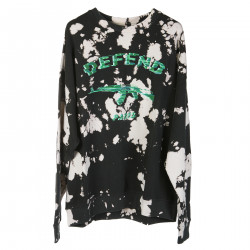 WHITE AND BLACK SWEATER WITH GREEN WRITTEN