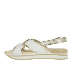 CROSSED WHITE AND GOLD SANDALS